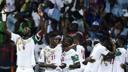 Senegal players swamp Sadio Mane (C) after his goal