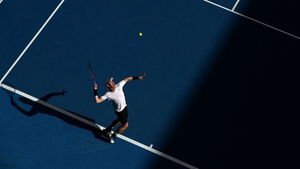 Andy Murray serves during the third round defeat of Sam Querrey