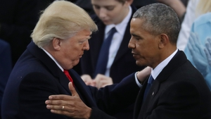 New US President Donald Trump with outgoing president Barack Obama at yesterday's inauguration