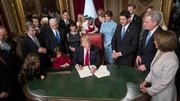 US President Donald Trump is joined by the congressional leadership and his family as he formally signs his cabinet nominations into law