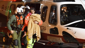 The three children survivors pulled out of the Rigopiano Hotel yesterday arrive by helicopter at the airport in Pescara