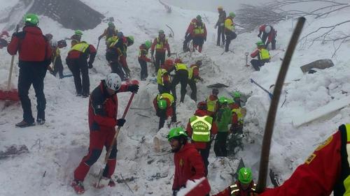 Soccorso Alpino volunteers and rescuers work at the hotel site in Rigopiano, Italy