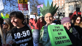 Protesters dress up for the Women's March in London