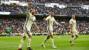 Sergio Ramos (L) acknowledges the home crowd