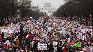 Protesters attend the Women's March on Washington, with the US Capitol in the background