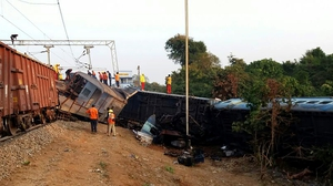 Indian rescue workers look for survivors at the site of the derailment