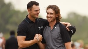 Tommy Fleetwood is congratulated by Martin Kaymer