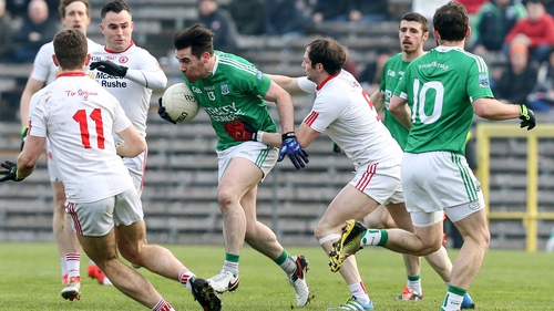 Barry Mulrone of Fermanagh is tackled by Ronan McNabb of Tyrone