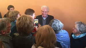 Crowds of wellwishers greet Fr Tony Flannery after he concluded this afternoon's mass in Galway