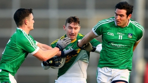 Limerick's Paul White and Ger Collins tackle James O'Donoghue