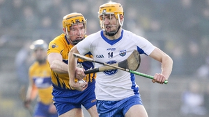 Waterford's Tadhg Fagan and Clare's Cian Dillon tussle for possession