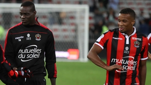 Mario Balotelli (L) and his French team mate Alassane Plea