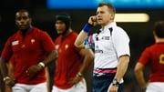 Rugby referee Nigel Owens waits to hear advice from a TMO regarding an important decision