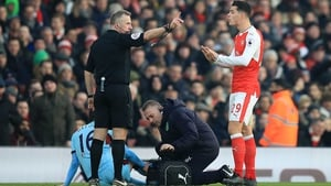 Granit Xhaka sees red for his challenge on Burnley's Steven Defour