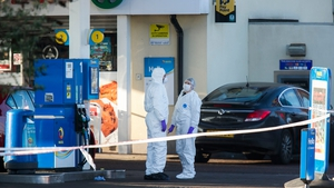 A PSNI officer was shot three times in the arm on Sunday