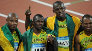 Jamaica's Asafa Powell, Nesta Carter, Usain Bolt and Michael Frater celebrate gold in 2006