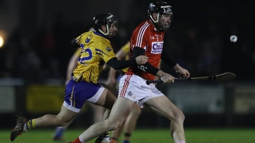 Clare's Cathal O'Connell chases Cork defender Mark Ellis