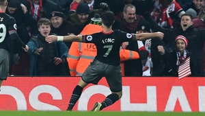 Shane Long celebrates with the travelling Southampton fans at Anfield