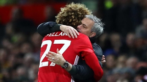 Jose Mourinho and Marouane Fellaini hug it out