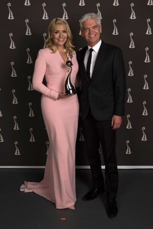 Holly Willoughby and Philip Schofield with their award Best Live Magazine Show. Loving Holly's pale pink backless dress