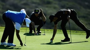 Tiger Woods; Dustin Johnson and Jason Day prepare to putt