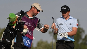Paul Dunne (R) is six off the lead at the Qatar Masters
