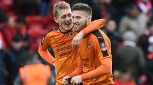 Matt Doherty (r) was one of the heroes for Wolves as they beat Liverpool