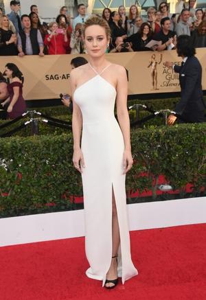 Brie Larson in her Jason Wu dress, Jimmy Choo shoes, and Repossi jewelry.
