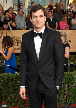 SAG host Ashton Kutcher pictured on the red carpet before opening the ceremony speaking out against Trump's Immigration Ban.