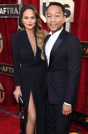 Someone had to rock the thigh-high split tradition and this time it's Chrissy Teigen with hubby John Legend.