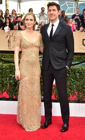 Emily Blunt, in an embellished Roberto Cavalli gown, with hubby John Krasinski.