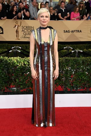 Mmmm: Always perfectly tailored Michelle Williams normally stands out on the red carpet and this Louis Vuitton dress is edgy just not wow.
