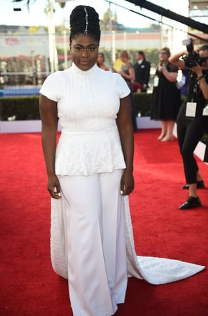 Mmmm: Orange is the New Black star (Taystee) Danielle Brooks' looks beautiful in her Christian Siriano top paired with white trousers but the whole outfit could do with a once-over.