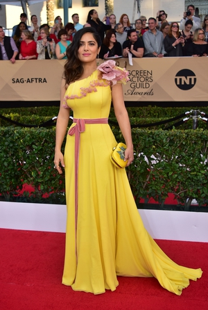 Salma Hayek: The actress shone in a buttercup yellow Gucci number paired with Irene Neuwirth jewelry.