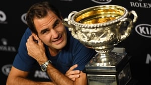 Roger Federer with the Australian Open Championship trophy