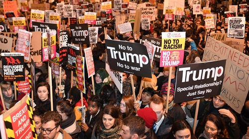 A large crowd protested outside Downing St this evening