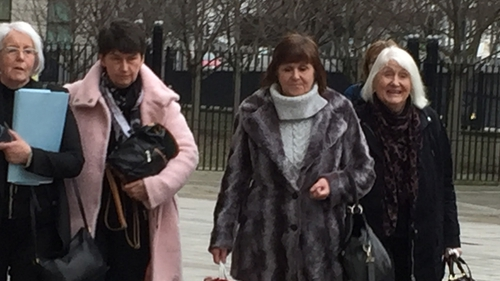 Bernadette McFall (left) and Molly Gilbert (second from right) at Laganside Courts where they gave evidence to the inquest into their brother's death