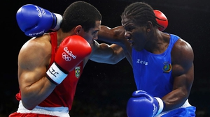 Hassan Ndam Njikam (R) was beaten in his first bout at Rio