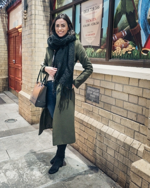 Josie McManus: The over-the-knee boot trend continues and Josie effortlessly pairs hers with jeans, a long coat and oversized scarf