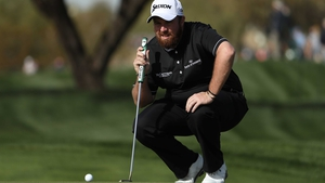 Shane Lowry lines up a putt on the ninth
