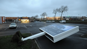 An advertising hoarding toppled by strong winds in Rochfort