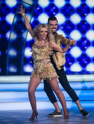 Week 5: Denise and Ryan were going for gold with their stunning samba. That dress was made for twirling in!
