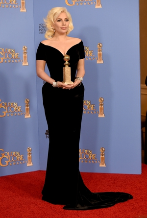 4. Looking like Marilyn Monroe in a black velvet gown at the 2016 Golden Globes. We're not used to this kind of look from Gaga, but we love it!