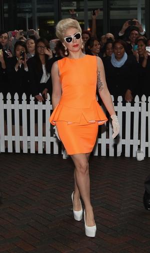 9. Arriving like a pin-up in her neon orange Antonio Berardi dress in Auckland in 2012.