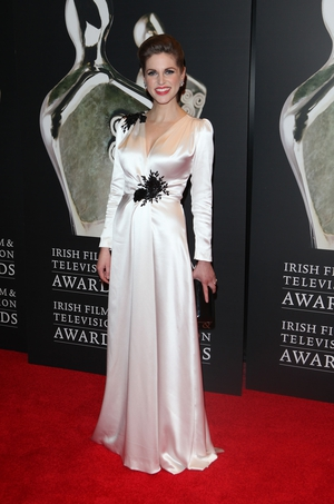 Talk about old school Hollywood glamour! Amy donned a fabulous white gown with black flower details to the Irish Film and Television Awards in 2012.