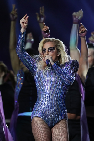 1. Last night's brand new SuperBowl outfit: A sparkly bodysuit by Versace and a matching eye make-up. Fabulously Gaga.