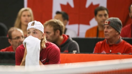 Denis Shapovalov reacts with disbelief after he hit the umpire with a ball unleashed in frustration