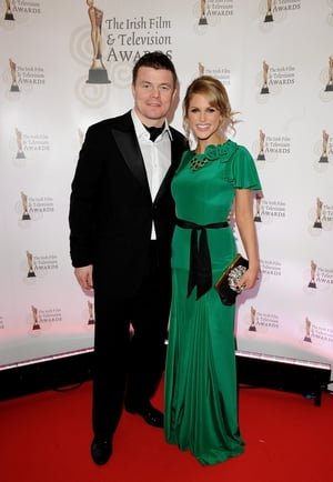 The actress wore a dreamy emerald gown by designer Belle & Bunty to the 2012 Irish Film and Television Awards ceremony pictured here with hubby Brian O'Driscoll.