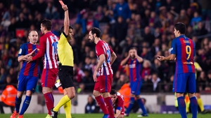 Suarez is dismissed for an elbow on Atletico midfielder Koke