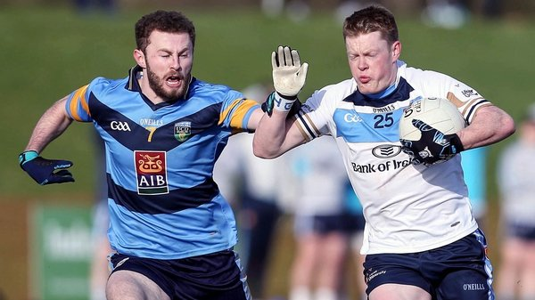 UUJ's Ryan McAnspie (R) is tackled by UCD's Jack McCaffrey